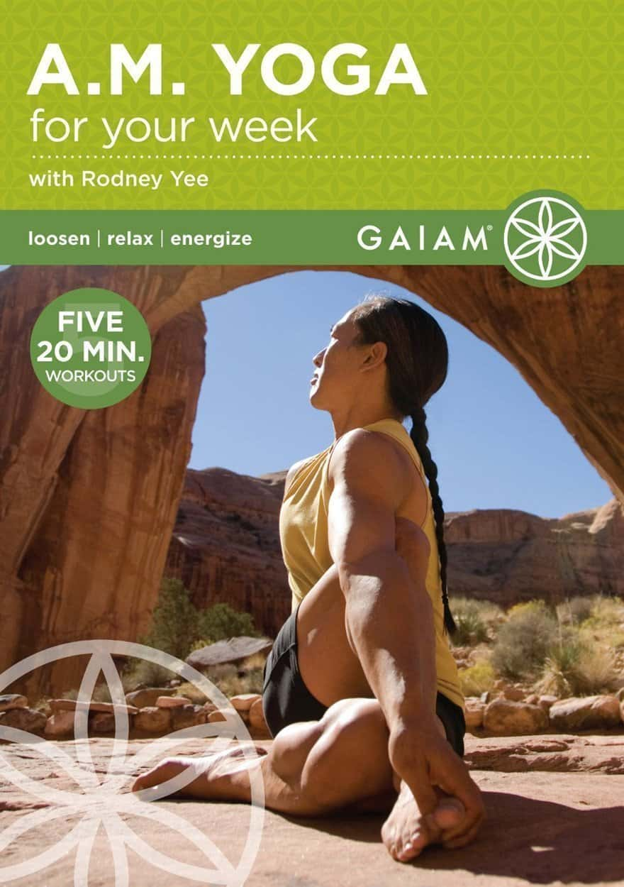 Rodney Yee cover photo for Gaiam yoga. Yoga shorts and yellow yoga shirt