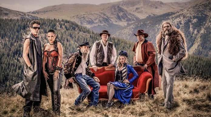 Prospectors intro wearing old west red corsette, blue silk dress, black leather sleeveless long vest Fur jacket western cloak and western hats
