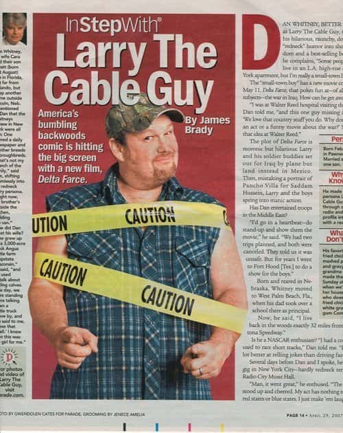 Newspaper tear sheet featuring a photo of Larry The Cable Guy wrapped in yellow caution tape