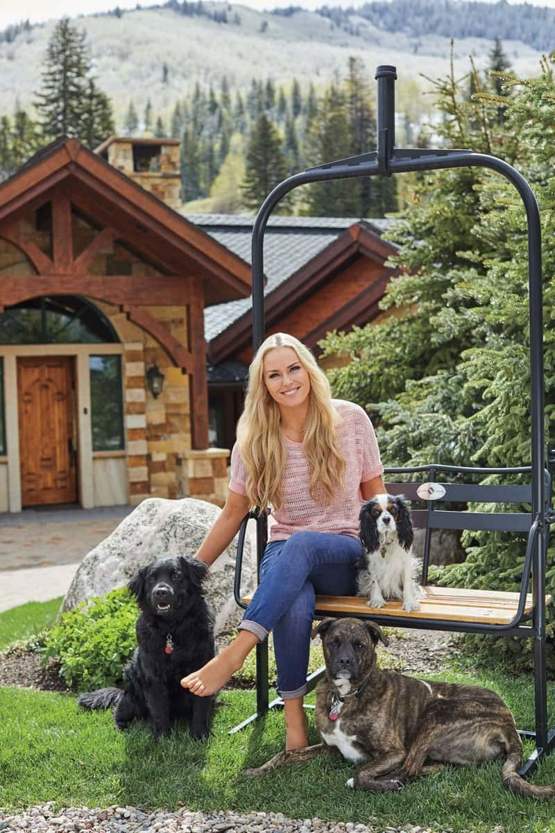 Lindsey Vonn poses for a shoot with People Magazine in front of her home in Vail, Colorado with three dogs