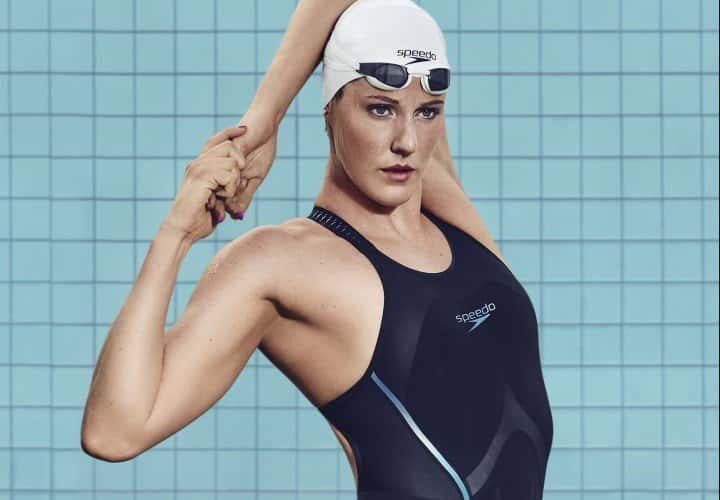 Missy Franklin performs a warm up stretch in a Speedo swim suit