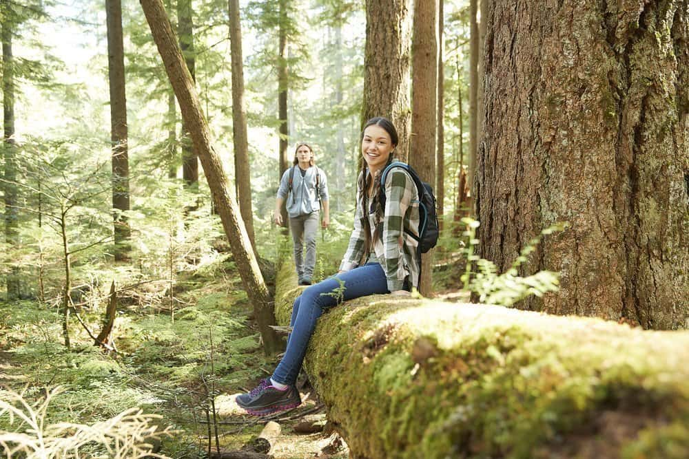 Man and woman enjoying the forest in Vancouver, Canada