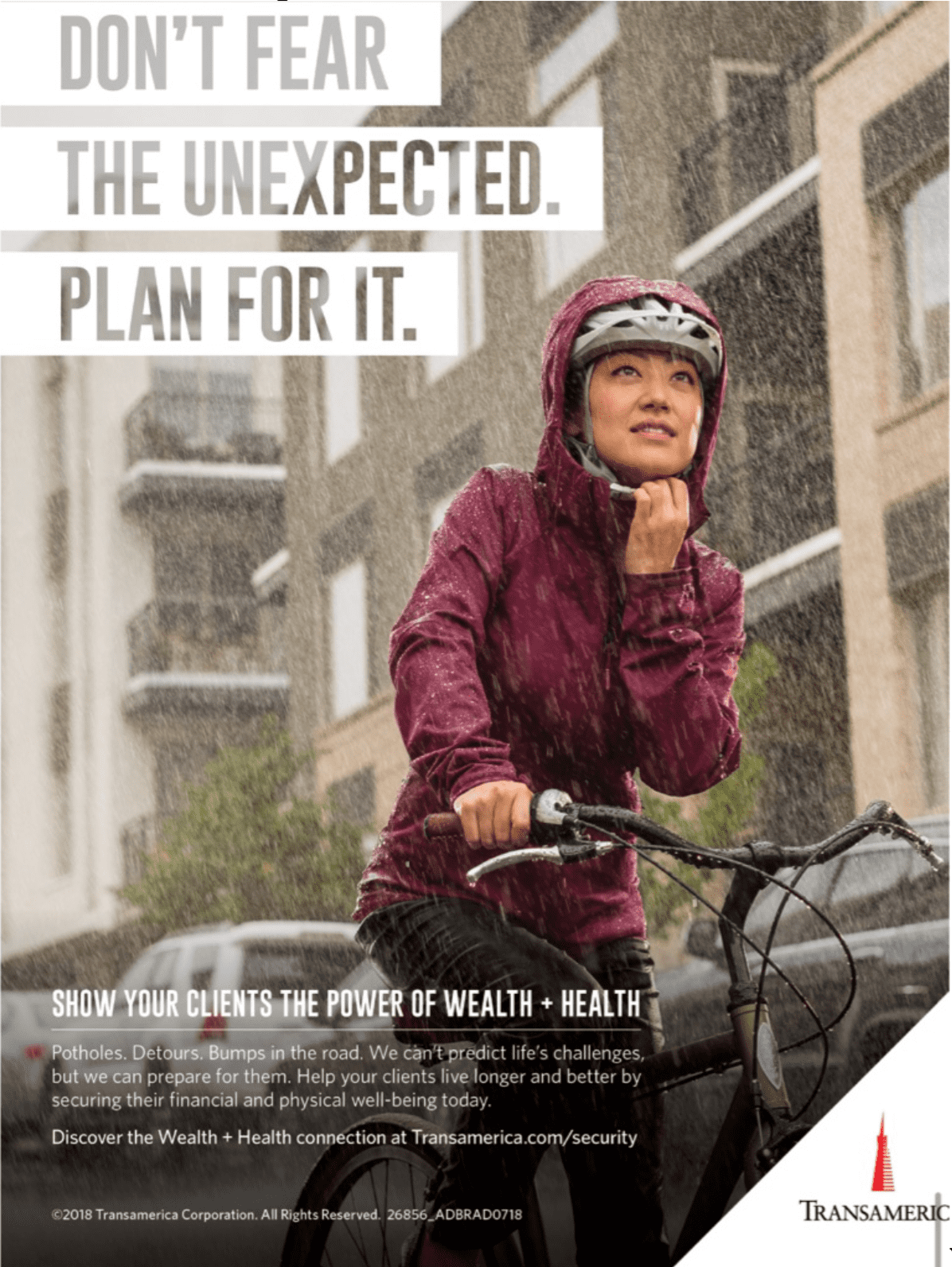 Print advertisement for Transamerica showing a woman riding a bike in the rain